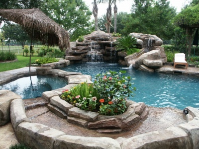 Laguna Pool with a waterfall feature and jacuzzi