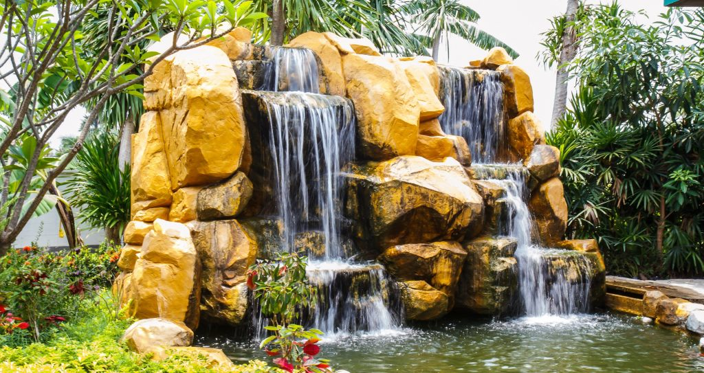 Backyard Waterfalls Pictures backyard waterfalls can turn your backyard into your very own paradise!
